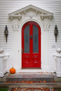 Red is a very versatile color for an entry door and it looks great with a lot of different colors of siding